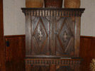 Armoire: Pine wood, black paint, 1890s, 78 inches high, Deschaine Family, Fort Kent, ME; carved with fancy brackets and diamond door decorations, black paint with 'sang-do-boeuf' red decorations. Photo: DP